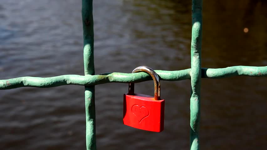 Red love lock with embossed heart.