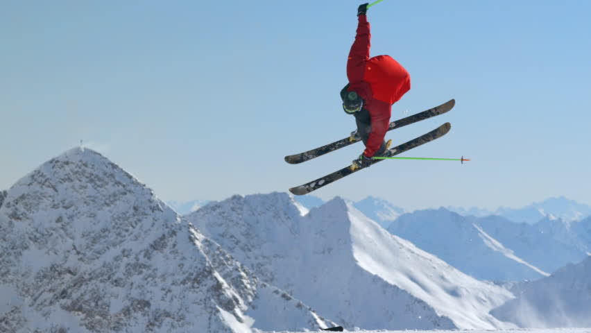 WS TS SLO MO View of free skier jumping scene with snowy mountains / Stubai, Central Eastern Alps, Innsbruck, 13/09/2014 | Shutterstock HD Video #14026355