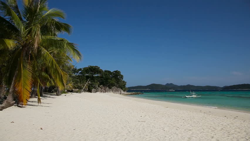 Tropical white sand beach,blue sky, clouds.Wave running on coast of tropical island.Concept travel.Landscape of a tropical beach with a boat.Beautiful tropical beach with clear blue water. | Shutterstock HD Video #14037611