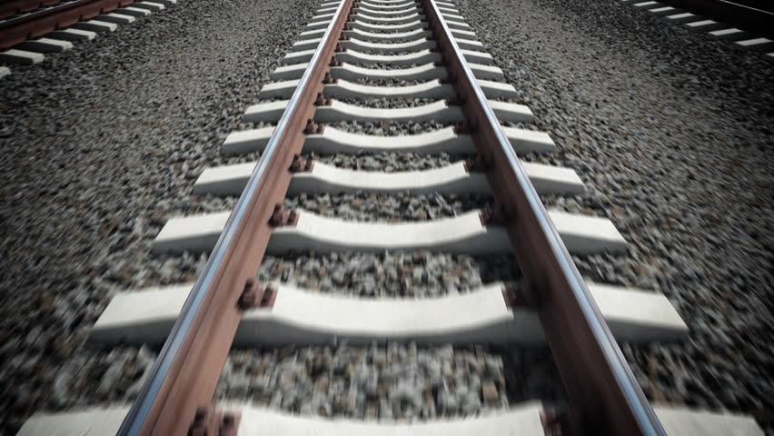 Camera moves along railway. Seamless loop.