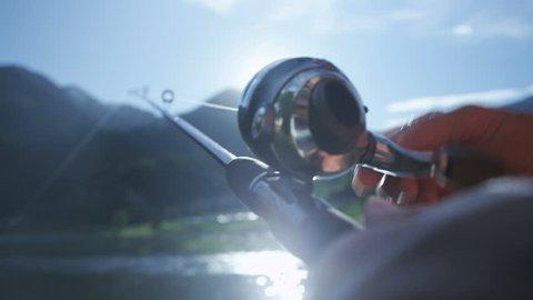 Man reeling in fishing line while fishing