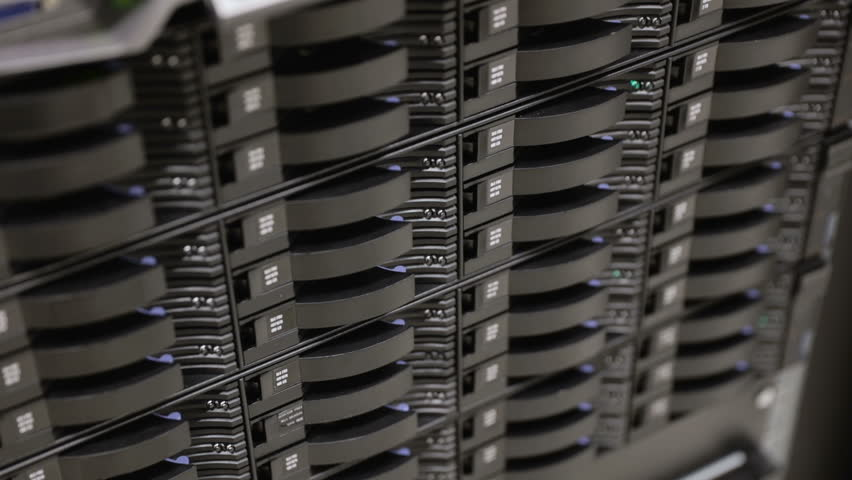Close up of hard drives in large SAN storage