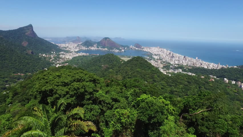Rio de Janeiro, Brasil landmark view with the city and de forest, from Christ the Redeemer with the Lake and the coast from Copacabana until Tijuca. Shoot from a drone in a aerial view.