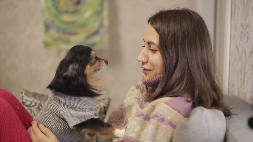 Mistress speaks with her little dog