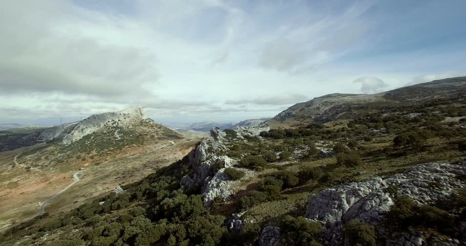 4K Aerial, flight over a plain field, Sierra De Las Nieves, Andalusia, Spain. Stabilized, graded and mostly accelerated versions #14071511