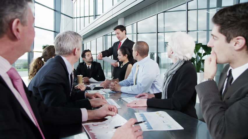 4k / Ultra HD version Attractive diverse business group in discussion in a business meeting in a large modern building with lots of natural light. Shot on RED Epic | Shutterstock HD Video #14127566