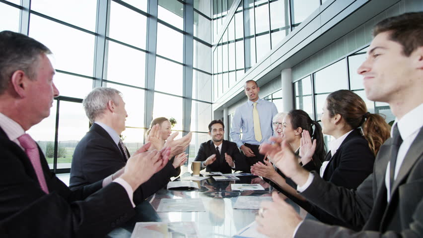 4k / Ultra HD version A confident and happy business team are holding a meeting in a light, modern office building. They are discussing ideas for their business development. Shot on RED Epic | Shutterstock HD Video #14127641
