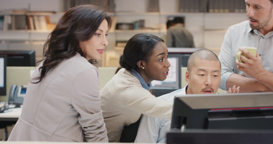 African american business woman leading Creative business team meeting.Happy people working in modern office at night discussing strategy using computer touch screen in diverse gender group | Shutterstock HD Video #14141756