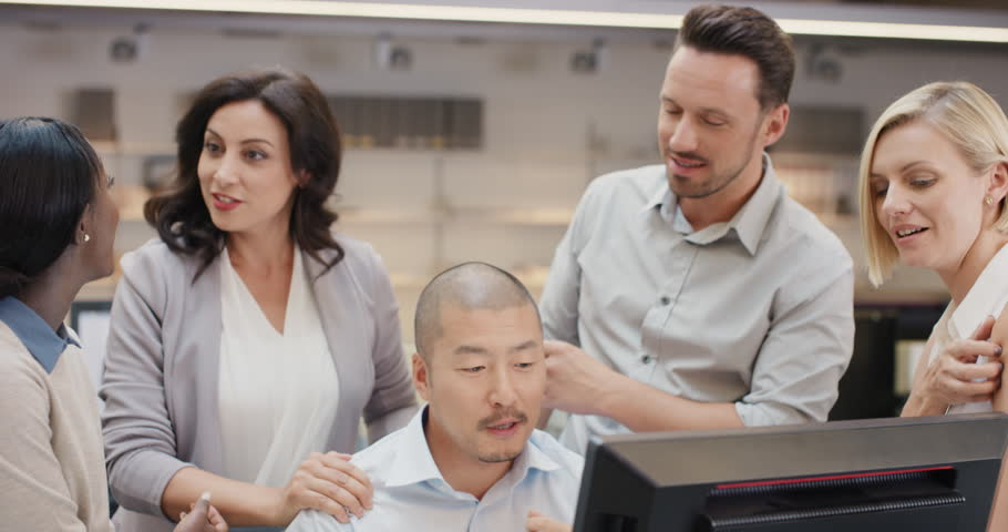 Creative business team meeting happy people working in modern office late at night discussing strategy using computer touch screen in diverse gender group | Shutterstock HD Video #14141831