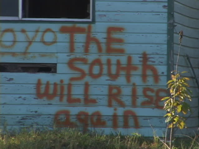 Graffiti on a building reads The South Will Rise Again.