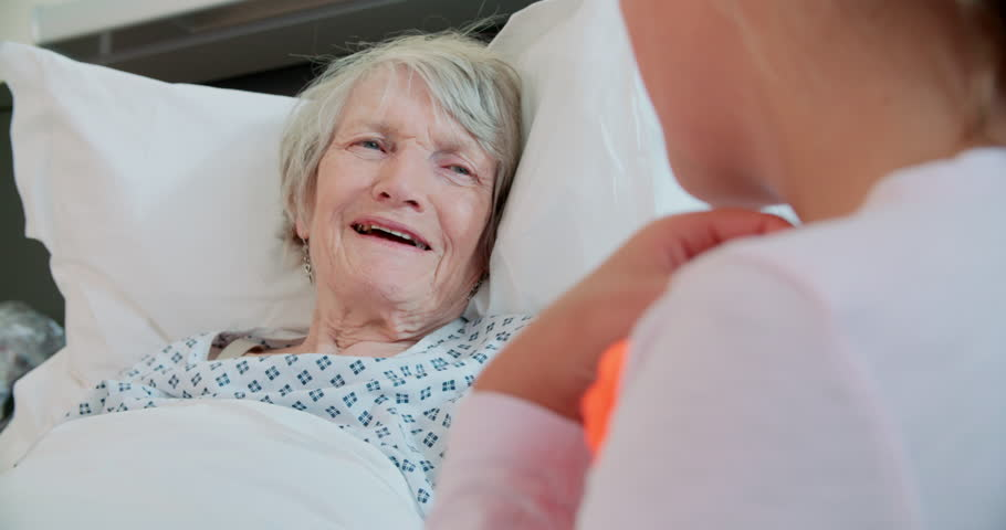 Granddaughter Visiting Grandmother In Hospital Bed | Shutterstock HD Video #14171411