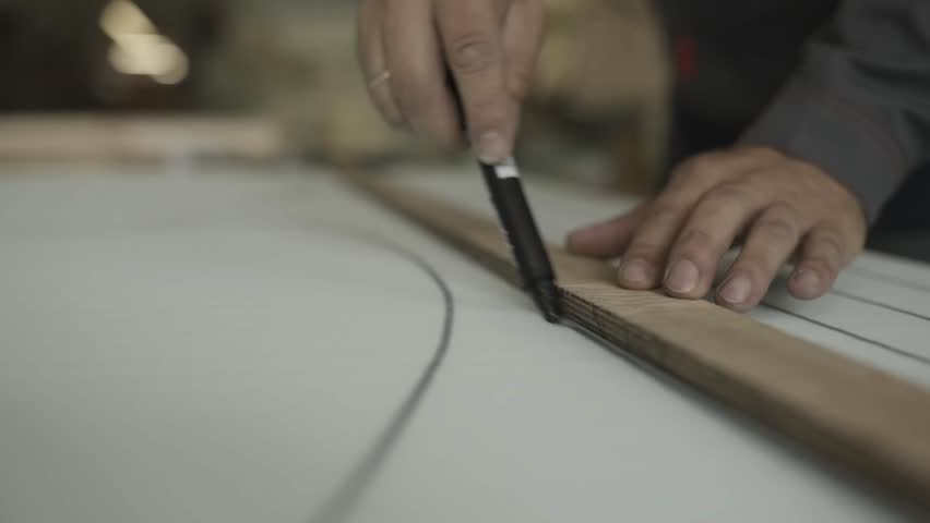 Man Draws Lines On Paralon With Straightedge By Marker In Furniture Factory    HD Stock Video