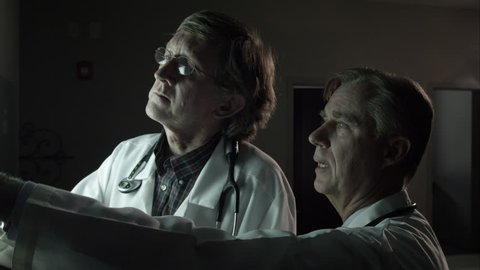 Two doctors referencing a patient's x-ray.