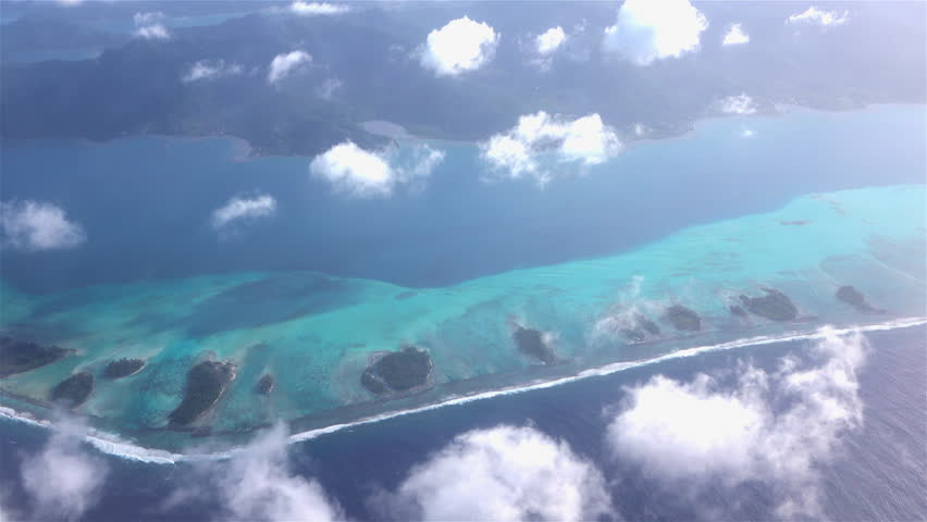 AERIAL: Beautiful dreamy Bora Bora atoll island with white sand reef around the main island. Flying above French polynesia for exotic summer vacation. | Shutterstock HD Video #14327431