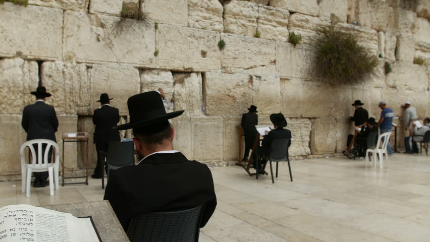 JERUSALEM, ISRAEL - April 10, 2015: Jerusalem western wall. The Western Wall or the Wailing Wall is the remaining wall of King Solomon temple where orthodox jews are praying.