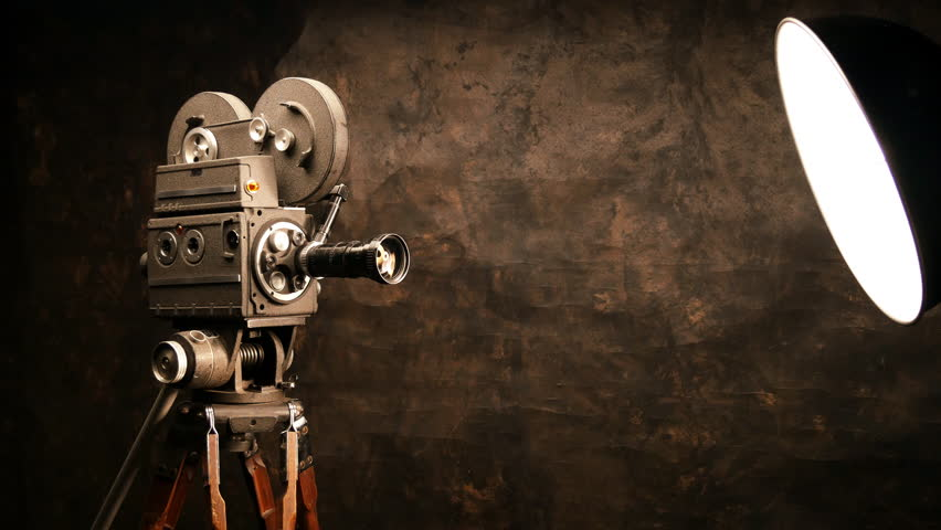 Vintage Hollywood Movie Camera in Front of Black Backdrop. Suitable for Tv Show, Film Title, or Credits. | Shutterstock HD Video #14355046