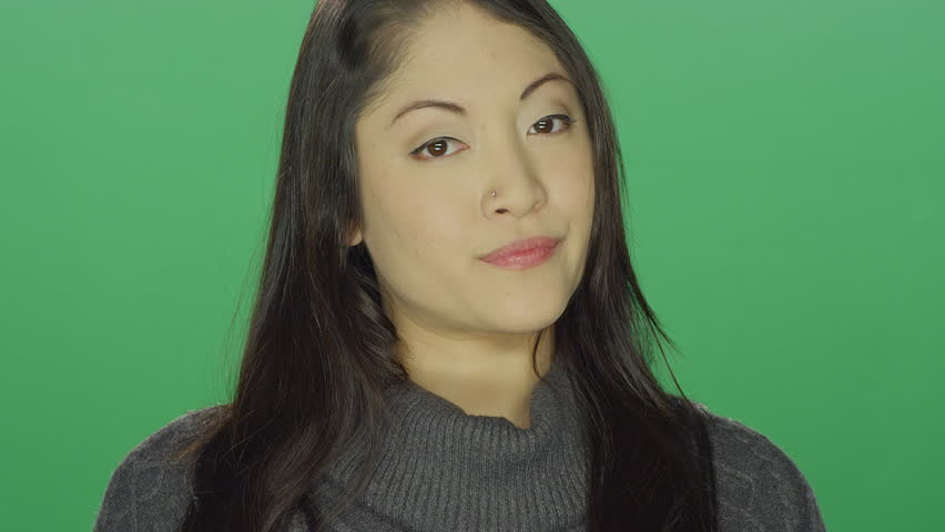 Beautiful young asian woman looking annoyed and angry, on a green screen studio background | Shutterstock HD Video #14360521