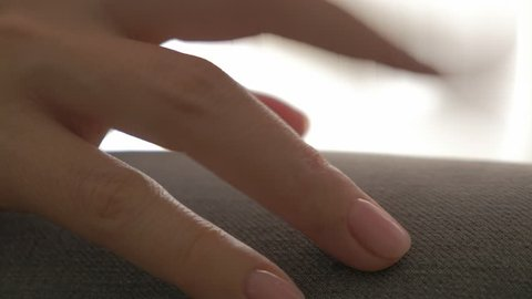 Fidgety female fingers symptoms of anxiety or nervous habits close-up 4K 2160p 30fps UltraHD video - Woman with mental or nerve breakdown tapping with fingers on leg 4K 3840X2160 UHD footage