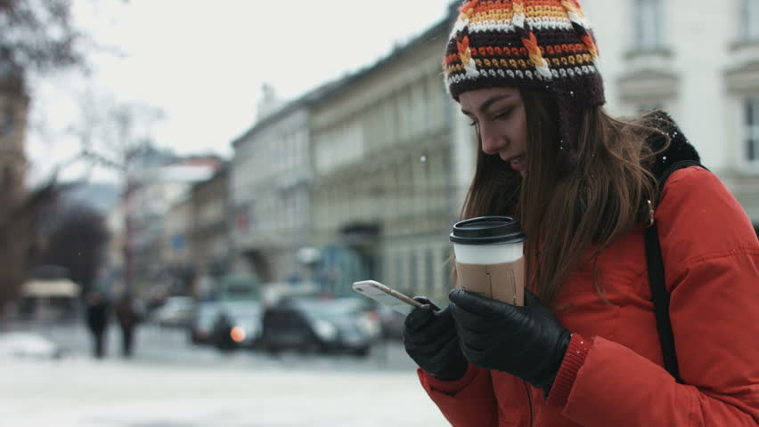 Young female being waiting for her friends outdoors and using smartphone to text. Girl is receiving a message on her mobile device. | Shutterstock HD Video #14393161