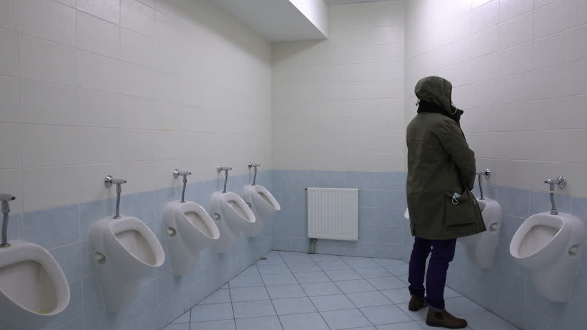 Video of men peeing at urinals