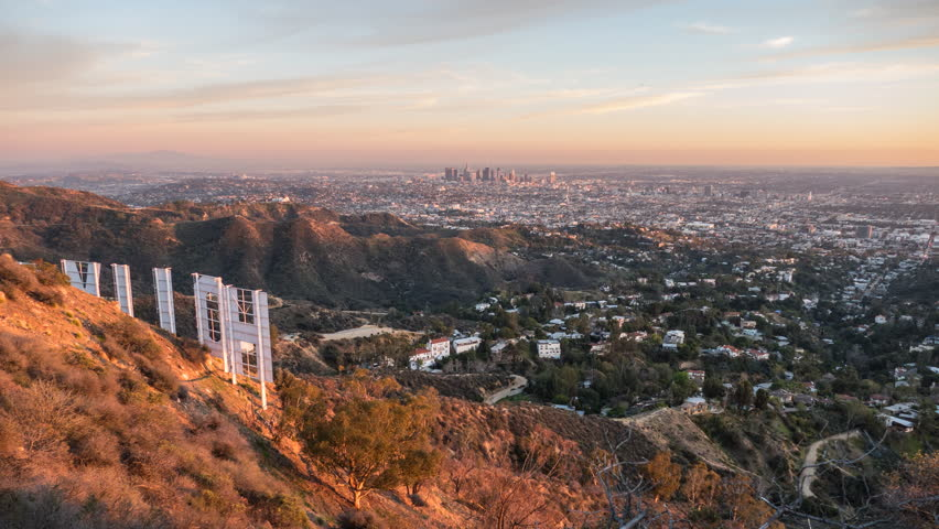 Los Angeles, California, USA - February 4, 2016:  Los Angeles sunset time lapse cityscape view from behind the Hollywood Sign.