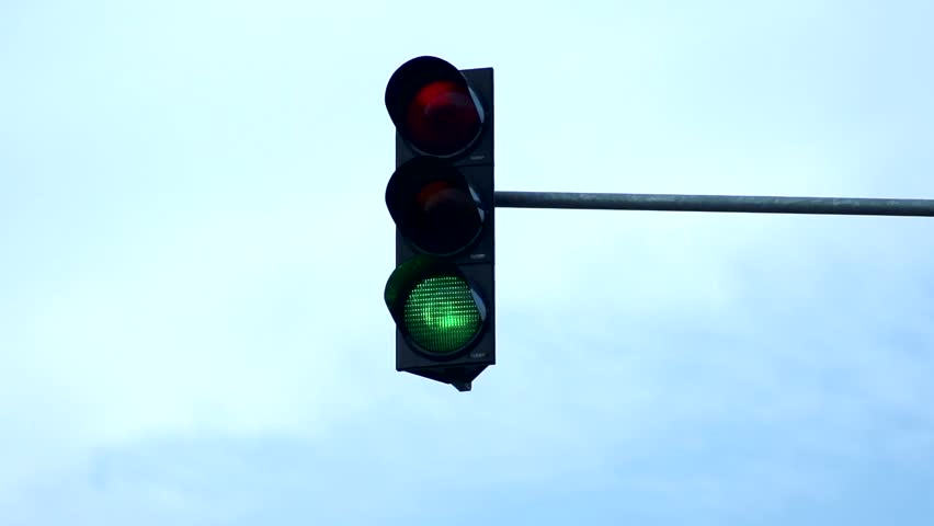 Slowmotion detail view on traffic lights shows all colour sign | Shutterstock HD Video #14457031