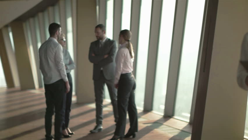 Business people group,  females as team leaders standing together  in modern bright office interior | Shutterstock HD Video #14457661