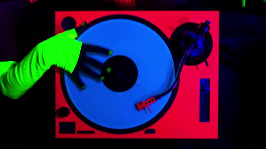 Sexy female DJ mixes in a club in UV fluorescent costume | Shutterstock HD Video #14478763
