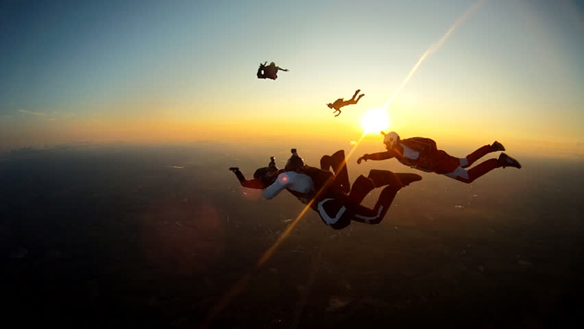Skydiving sunset silhouette | Shutterstock HD Video #14486461