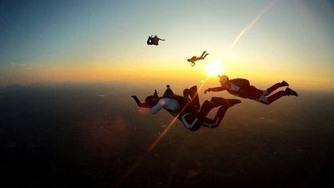 Skydiving sunset silhouette