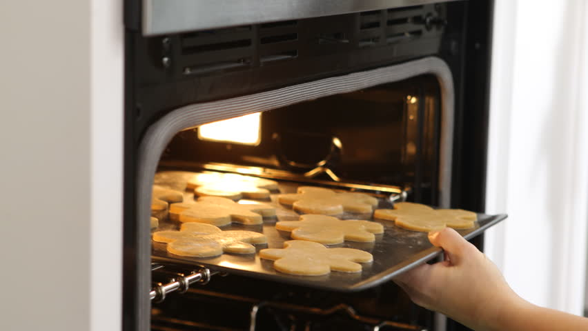 Putting Gingerbread Cookies Into Oven Stock Footage Video