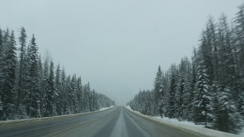 Driving on the TransCanada highway in winter. Between Field and Leanchoil, BC. Straight section of the highway in BC, Canada.