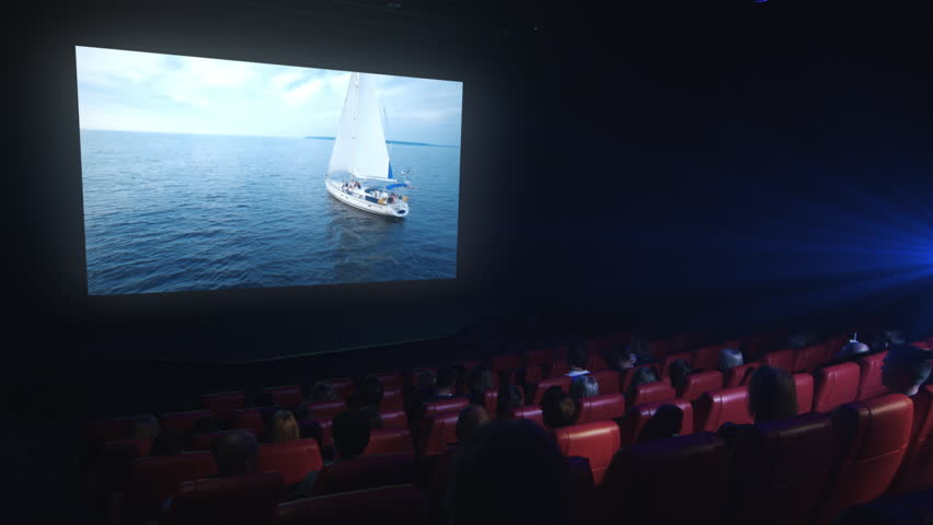 Group of people are watching a drama film screening in a movie cinema theater.