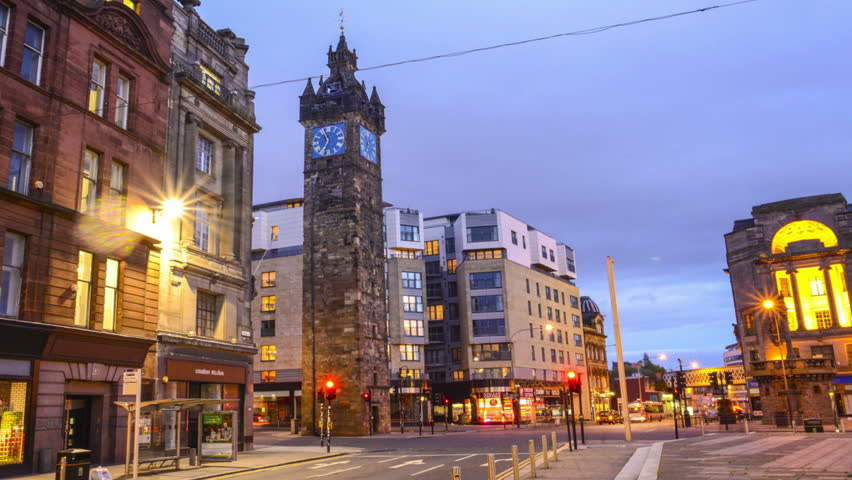 TOLLBOOTH AND CITY CENTRE, GLASGOW OCTOBER 2014. Glasgow city at night time lapse with clock tower tollbooth and traffic.