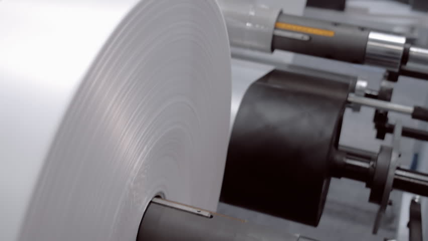 The technological cycle of industrial extrusion equipment - from storage tank with polymer granules, into the roll for the production of plastic bags of low pressure. Shot in motion
