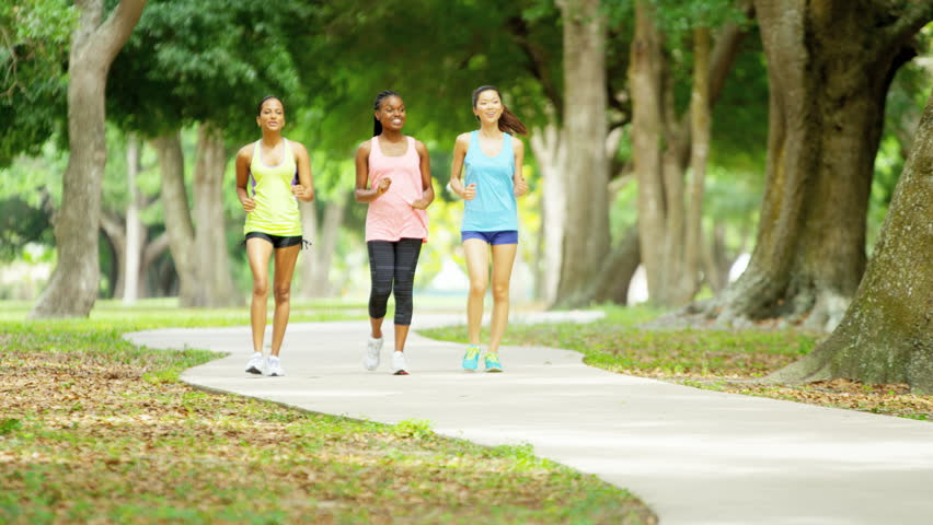 Young Pretty African American Asian Indian Females Outdoor Fitness Weight Loss Healthy Activity Power Walking Red