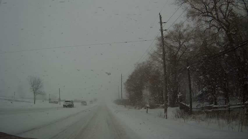 Ontario, Canada, February 2016 POV Dashcam driving in snowstorm and blizzard conditions | Shutterstock HD Video #14578681
