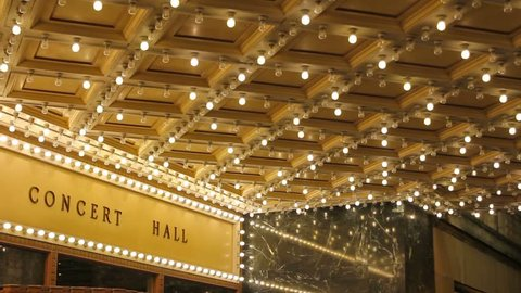 High definition movie of blinking concert hall theater ceiling lights on broadway along a entertainment street 1080p
