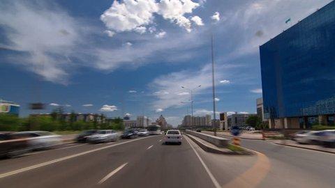 Car drives on street Traffic over the wide boulevards of Astana timelapse hyperlapse drivelapse in Kazakhstan
