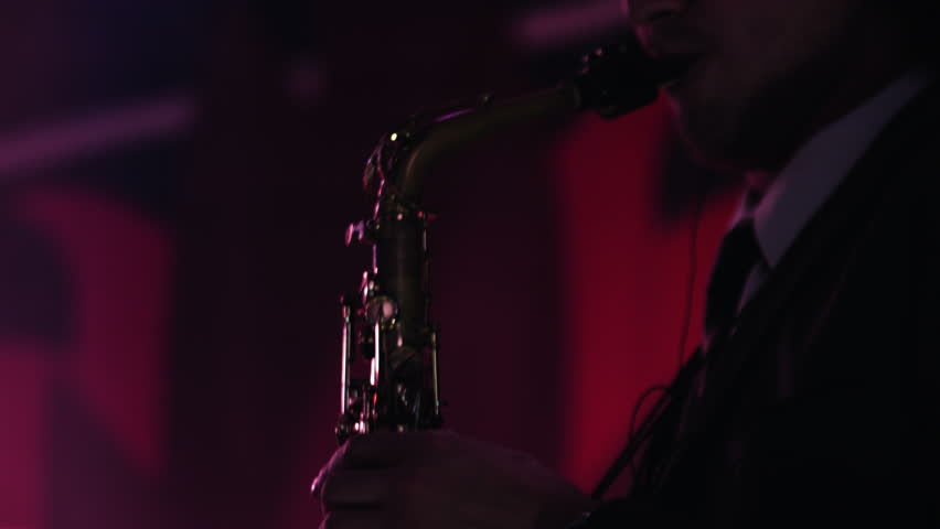 Close-up footage of caucasian man playing saxophone at nightclub. | Shutterstock HD Video #14615911