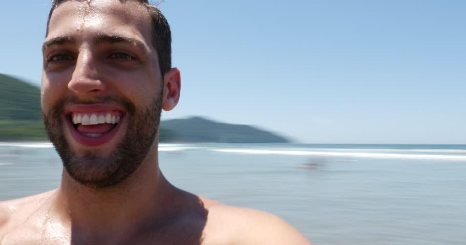 Young man taking selfie on brazilian beach