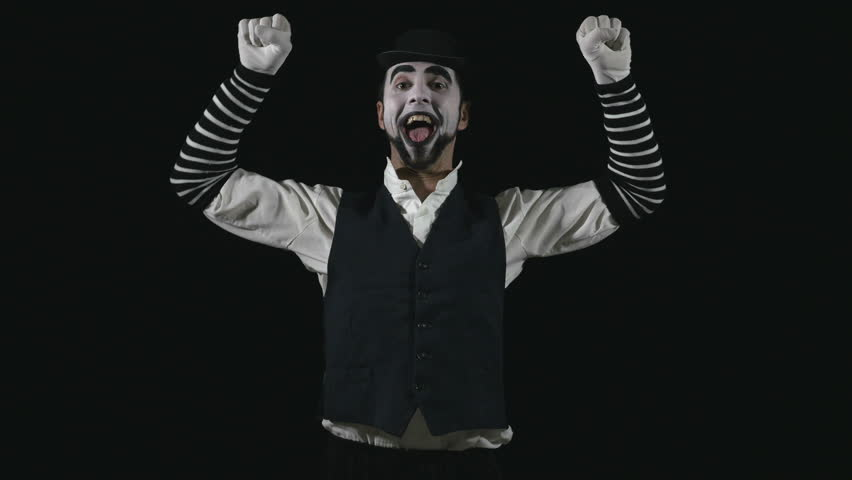 Young funny mime climbing and performing a pantomime act