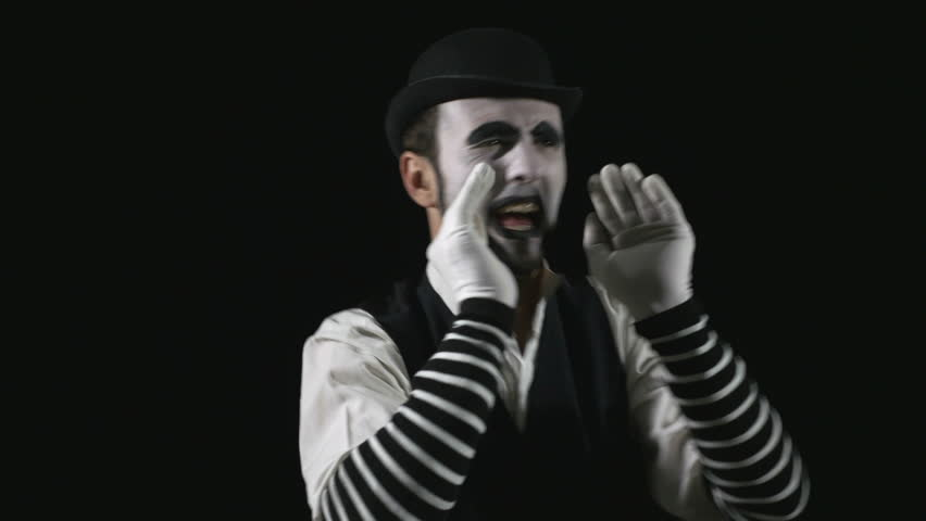 Young hilarious mime shouting using a megaphone