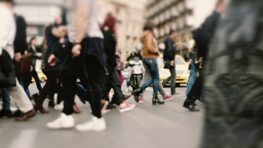 People pedestrians walk/cross big city intersection slow motion 100p.Gimbal stabilized tracking shot of an anonymous crowd mostly of young age getting across a busy city street.No logos/faces visible. | Shutterstock HD Video #14663791