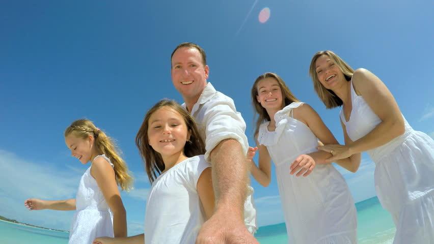Selfie portrait of Caucasian family enjoying vacation beach   Shutterstock HD Video #14689261