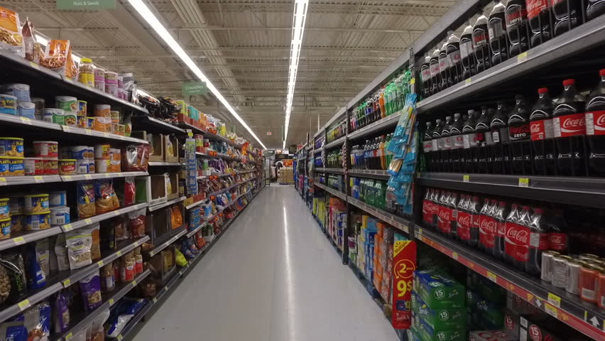 MONTREAL, CANADA - FEBRUARY 2016: Slow Motion: Walking through Walmart aisle (Chips, snacks, soda drinks & fast food)