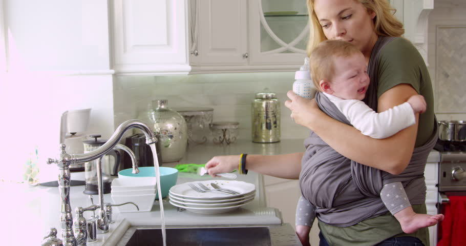 Busy Mother With Baby In Sling At Home Shot On R3D