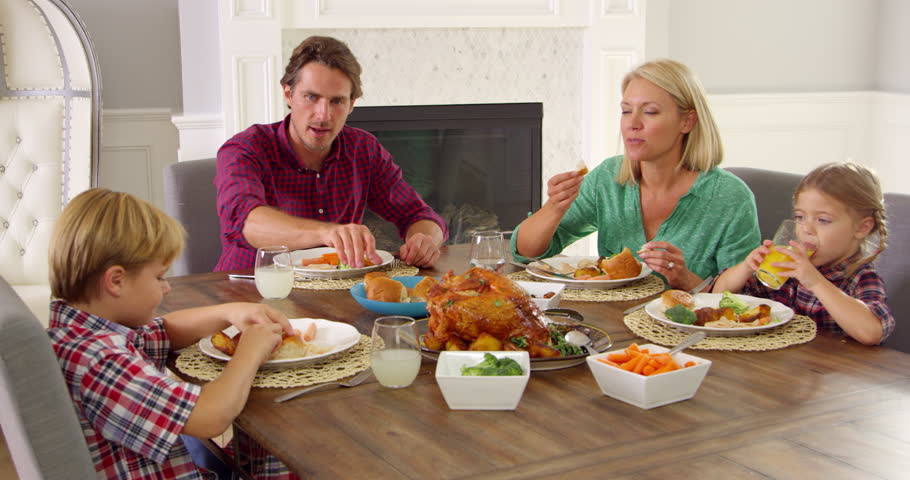 Family Sitting Around Table Eating Stock Footage Video