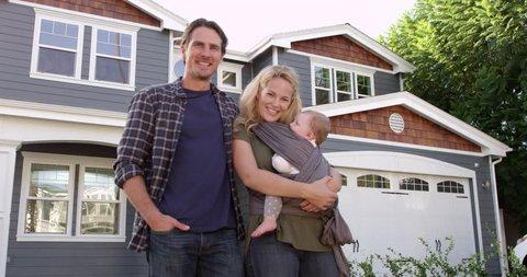 Portrait Of Family Standing Outside House Shot On R3D