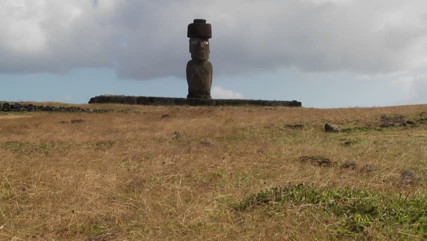 Wind blows across the grass in this lonely Easter Island scene.